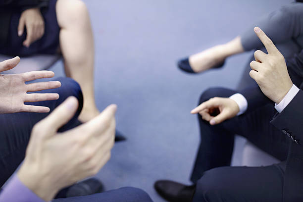 Hands of business people interacting in office meeting stock photo