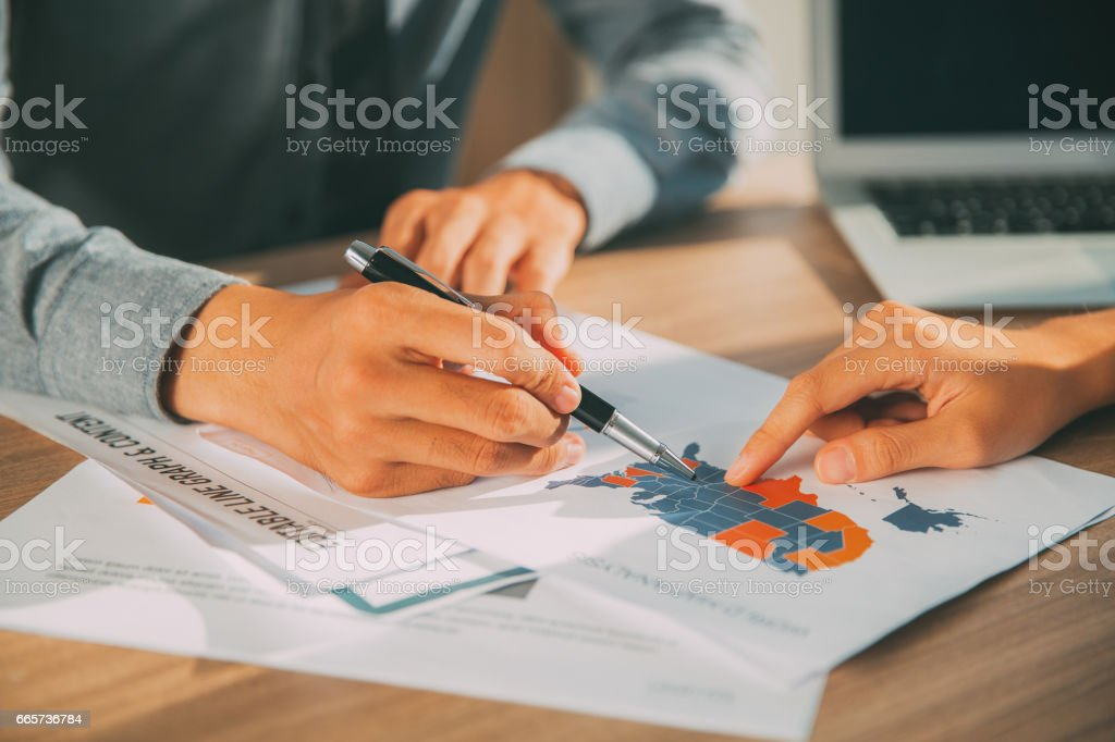 Hands of business people pointing at USA map stock photo