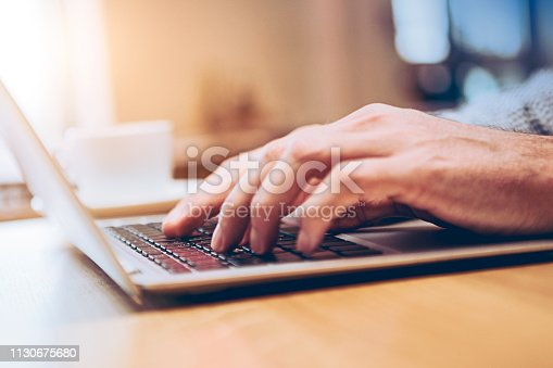 Hands of business person working on laptop
