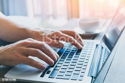 istock hands of business person working on computer 879813798