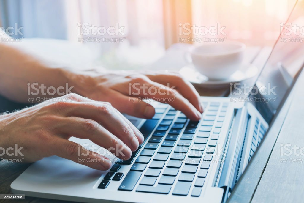 hands of business person working on computer stock photo
