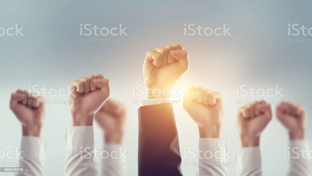 Hands of Business team raised fist air Corporate Celebration victory, success and winning concept. stock photo
