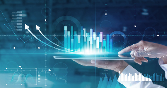 1025744818 istock photo Hands of businessman analyzing sales data and economic growth graph chart on tablet and hologram screen. Business strategy and digital data, business technology, digital marketing. 1165053279