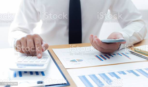 Hands of businessman are holding large amounts of money to prepare picture id1197658299?b=1&k=6&m=1197658299&s=612x612&h=9jrcelfoat2iowd fzubpywqx1ctuzxbcdjftnmaid4=