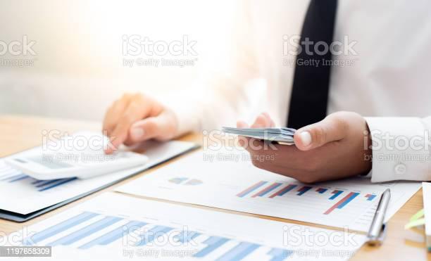 Hands of businessman are holding large amounts of money to prepare picture id1197658309?b=1&k=6&m=1197658309&s=612x612&h=ufgkgmjcaoh5qzitc2hrzurzifu6vneq2toblcjpozy=