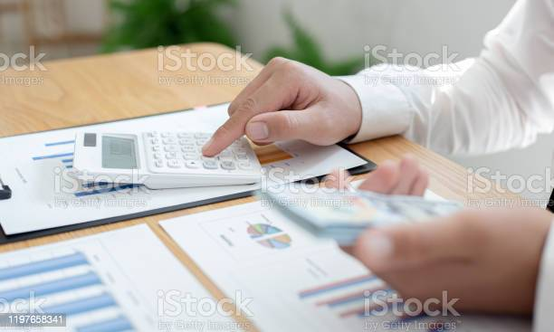 Hands of businessman are holding large amounts of money to prepare picture id1197658341?b=1&k=6&m=1197658341&s=612x612&h= mok2phctzimqgtibdyivb0fjikjdz1kwrplyf7wj6q=