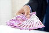 istock Hands of businessman holding money, Indian Rupee currency 947648838