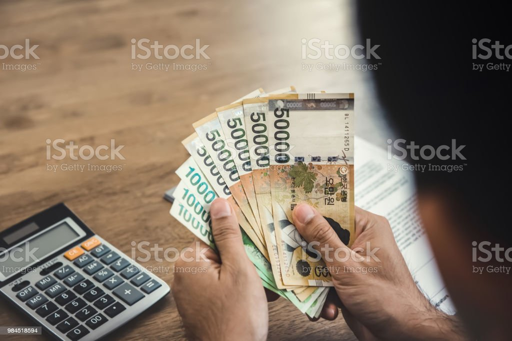 Hands of businessman holding money, South Koren won banknotes stock photo