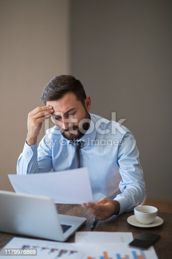 801895196 istock photo Hands of Businessman Notebook and documents working 1179976869