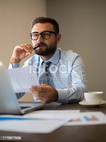 801895196 istock photo Hands of Businessman Notebook and documents working 1179977509