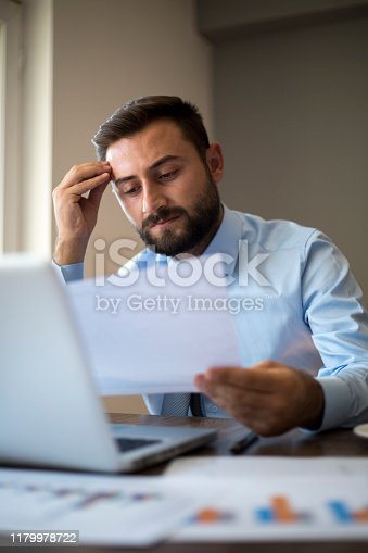 801895196 istock photo Hands of Businessman Notebook and documents working 1179978722