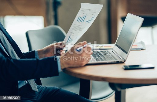 istock Hands of Businessman Notebook and documents working 934662002