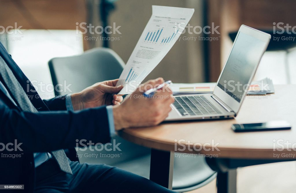 Hands of Businessman Notebook and documents working stock photo