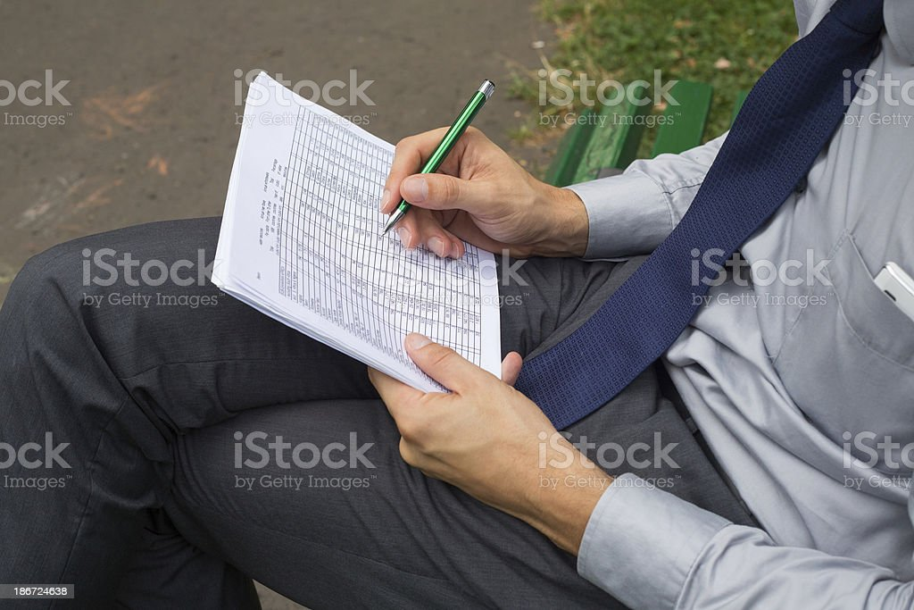 Hands of businessman with  notes and pen. royalty-free stock photo