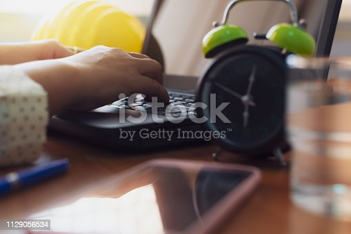 Hands of businesswoman typing laptop on working desk in office.  Business and technology concept.