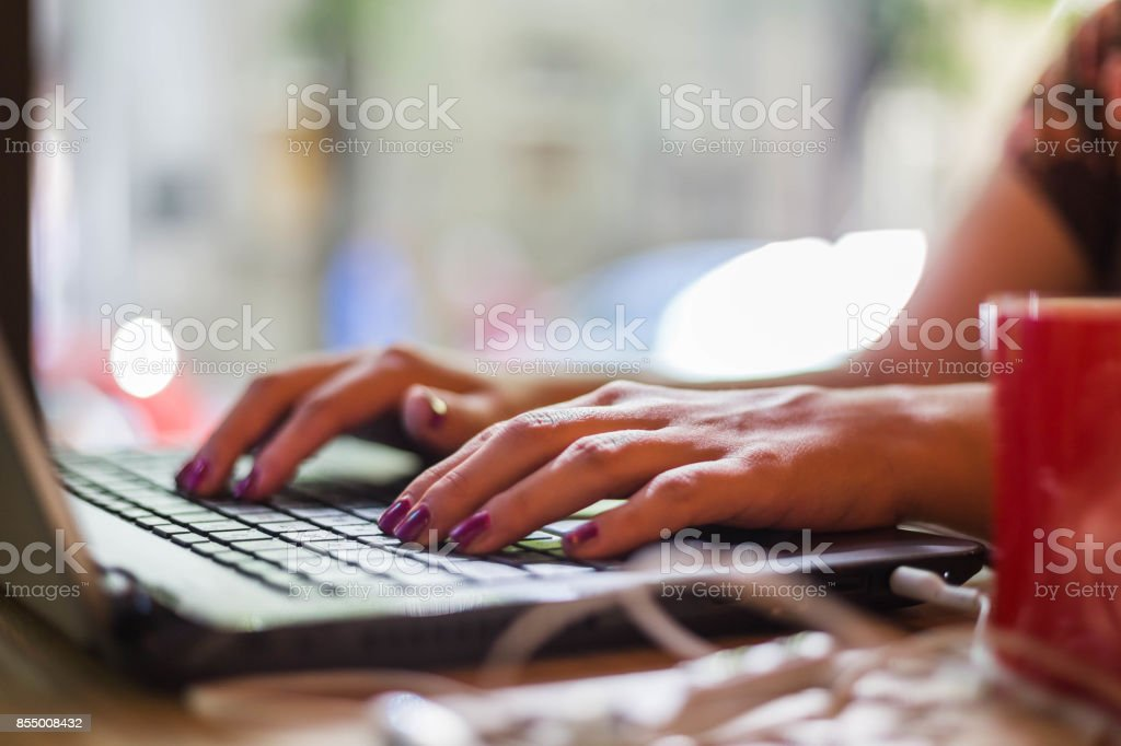 Hands of businesswoman typing on laptop keyboard stock photo