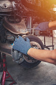 istock Hands of car mechanic in auto repair service. 1023358690