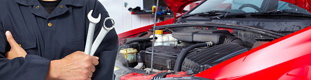 hands of car mechanic with wrench in garage. - garagiste photos et images de collection