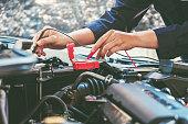 istock Hands of car mechanic working in auto repair service. 1062331030