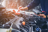 istock Hands of car mechanic  working in auto repair service. 693170166