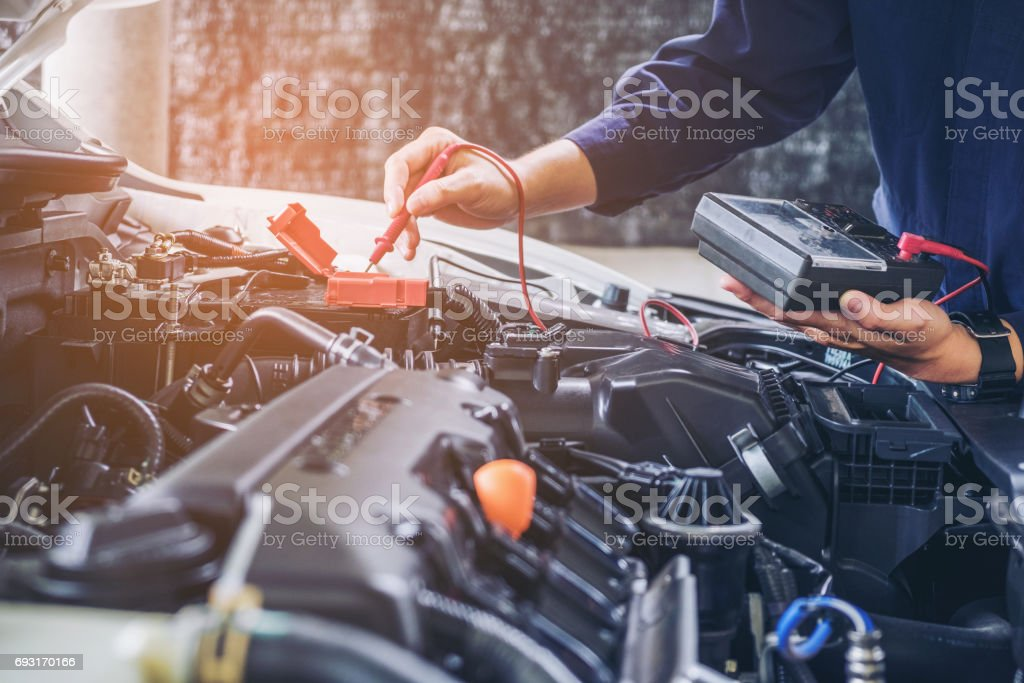 Hands of car mechanic  working in auto repair service. - foto stock