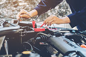 istock Hands of car mechanic working in auto repair service. 919423846