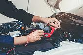 istock Hands of car mechanic working in auto repair service. 923542934