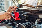 istock Hands of car mechanic working in auto repair service. 994672270