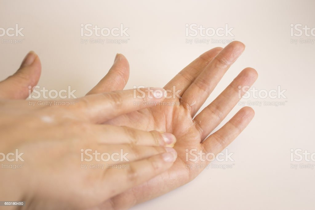 Hands of caucasian woman selfmassage stock photo