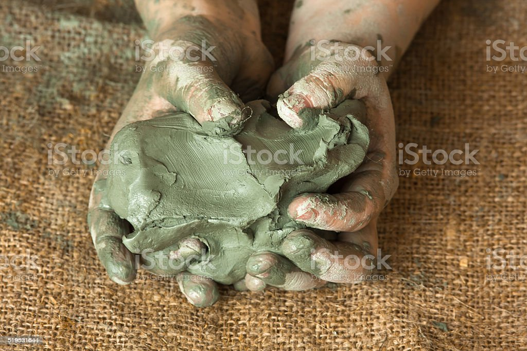 hands of child with blue clay stock photo