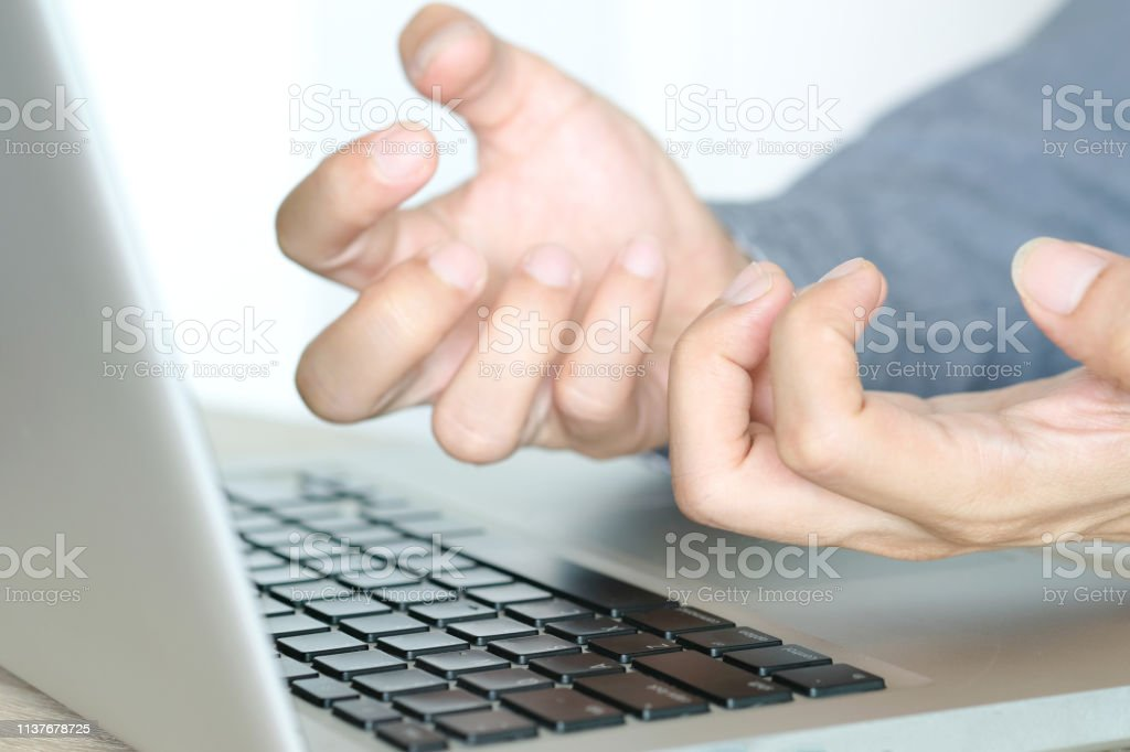 Hands of computer users have pain and injury to the fingers. From...