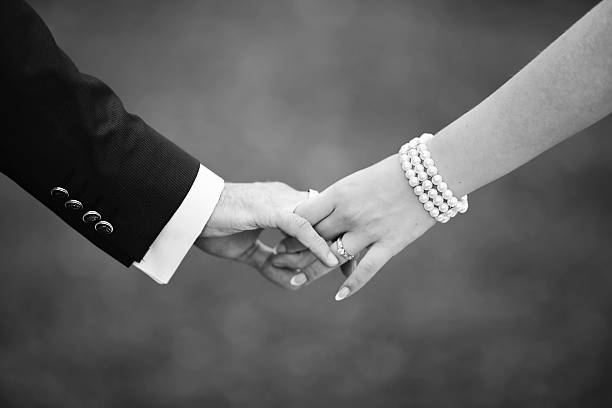 hands of couple in love stock photo