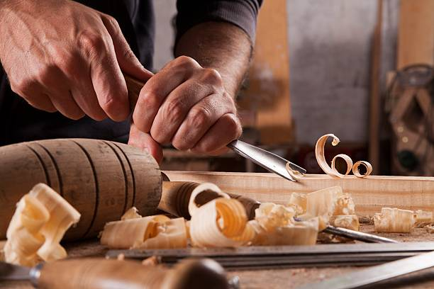 Hands of craftsman carve  with a gouge - foto de acervo