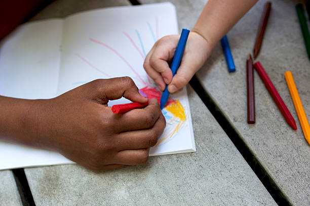 Hands of creative children drawing on paper. – Foto