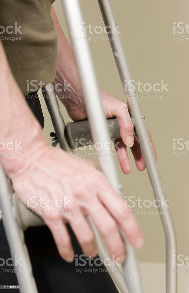 Hands of disabled woman on crutches royalty-free stock photo