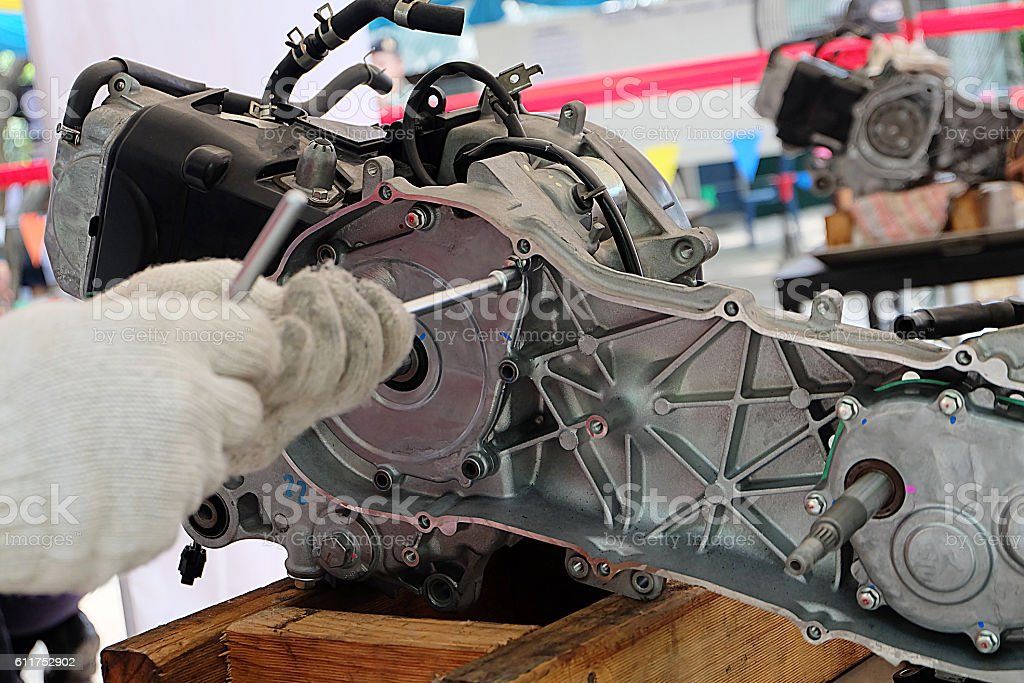 Hands of disassembly kit motorcycle in repair service. stock photo