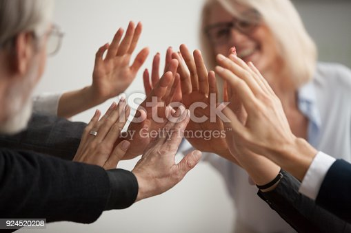 istock Hands of diverse business people giving high five, close up 924520208