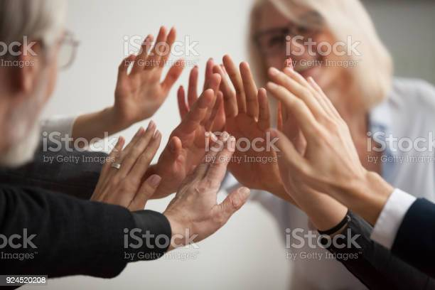 Hands of diverse business people giving high five close up picture id924520208?b=1&k=6&m=924520208&s=612x612&h= c8903jhlyevwclrbsojia s5anchice3fgqutzlr08=