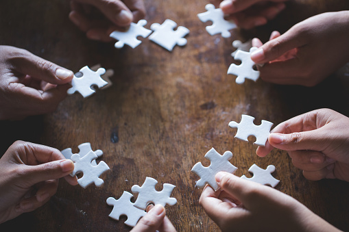 Hands Of Diverse People Assembling Jigsaw Puzzle Youth