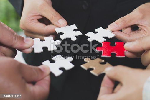 istock Hands of diverse people connecting puzzle together,  team engaging in finding best business solutions for successful teamwork, teambuilding unity concept. 1030912222