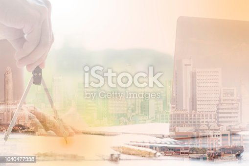 681242254 istock photo Hands of engineer use divider drawing, Hands of architect or engineer working on blueprint on model building and engineering tools in working site, Construction concept, architectural project. 1040477338