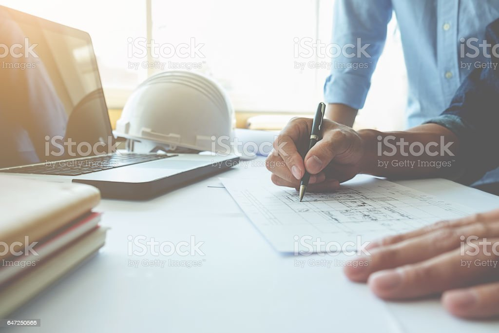 Hands of Engineer working on blueprint Construction concept. Engineering tools. Vintage tone. stock photo