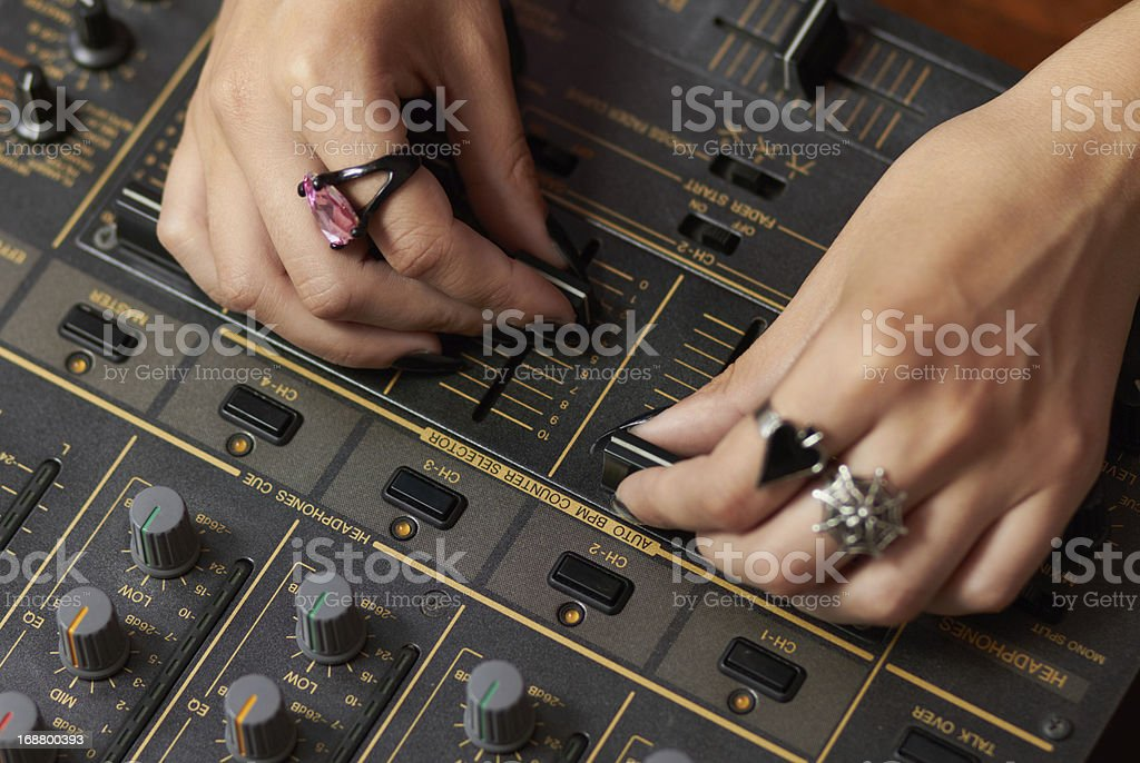 Hands of female DJ mixing music royalty-free stock photo