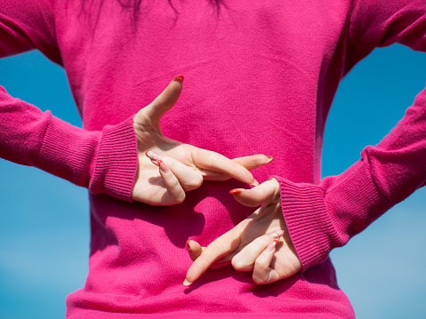 istock Hands of female person in pink blouse 1130693244