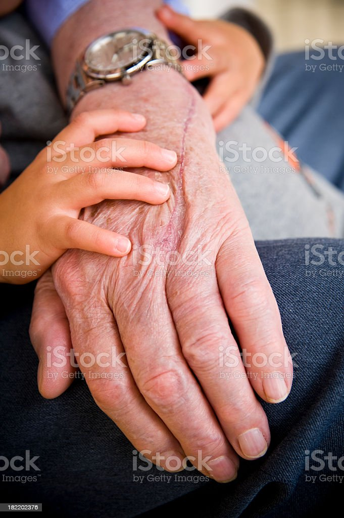 Hands of great grandfather and son royalty-free stock photo