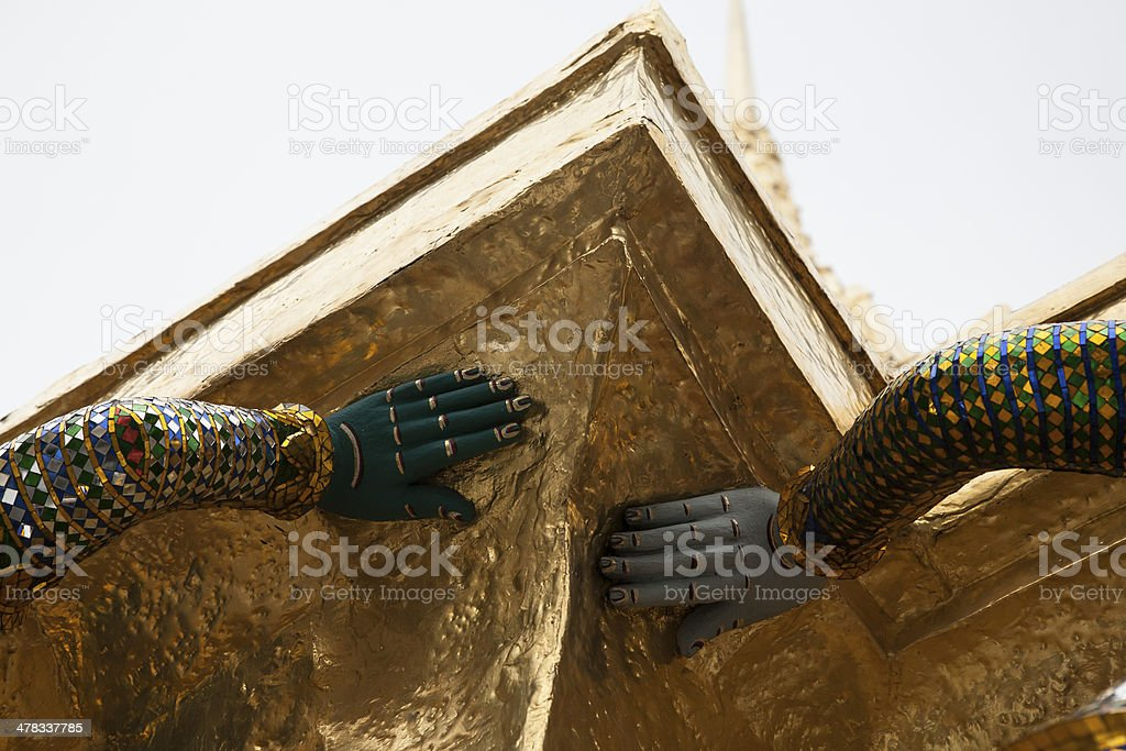 Hands of green giant guardian sculpture royalty-free stock photo