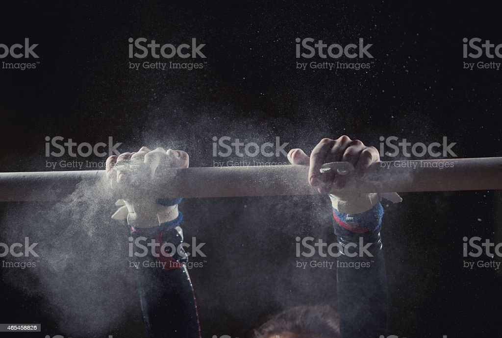 hands of gymnast hands of gymnast with chalk on uneven bars 2015 Stock Photo