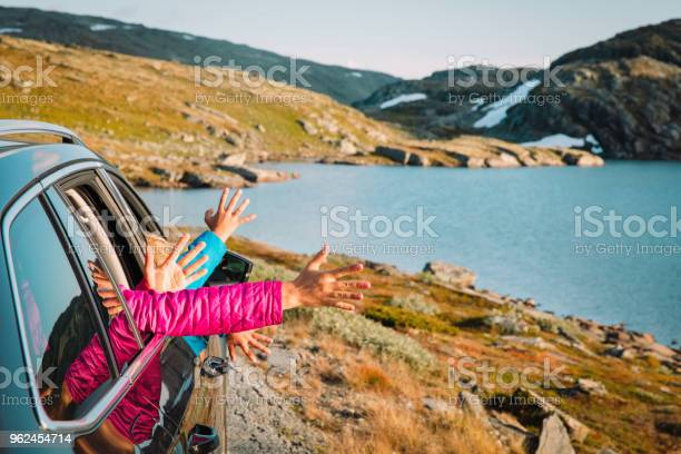 hands of happy family travel by car in mountains