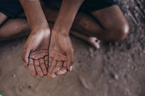 hands of hunger child hands poor child or beggar begging you for help sitting at dirty slum. concept for poverty or hunger people,human rights,donate and charity for underprivileged children in third world poverty stock pictures, royalty-free photos & images