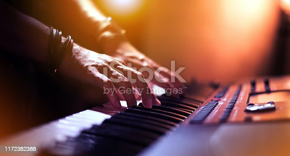 Image of Hands of keyboard player at the stage.